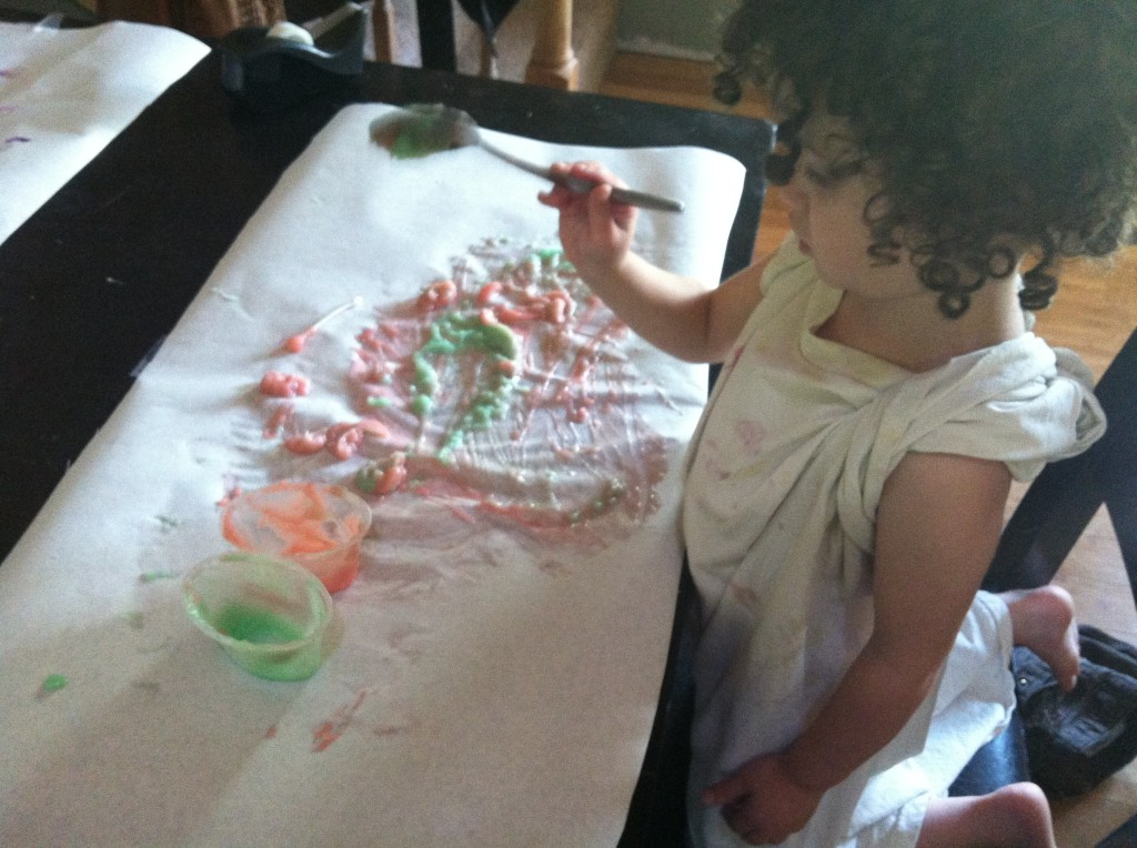 It started out as finger-painting, but eventually her aversion to sticky fingers kicked in and she used a spoon instead.
