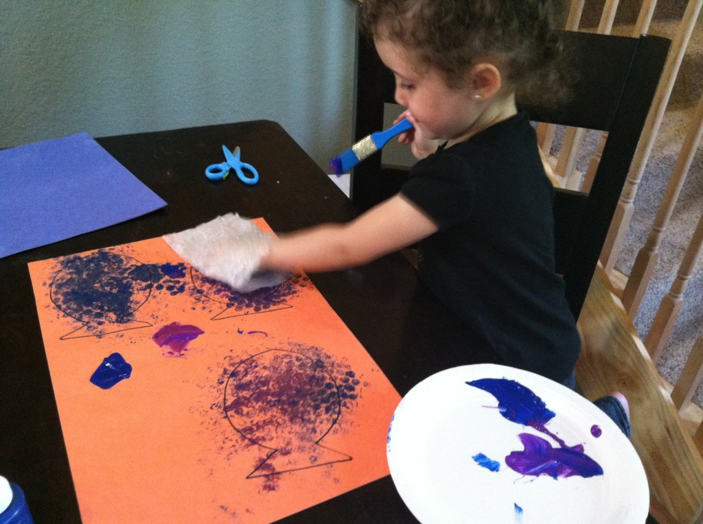 She really enjoyed the stamping part! I had already traced a fish shape onto the paper to make it easy to cut out.
