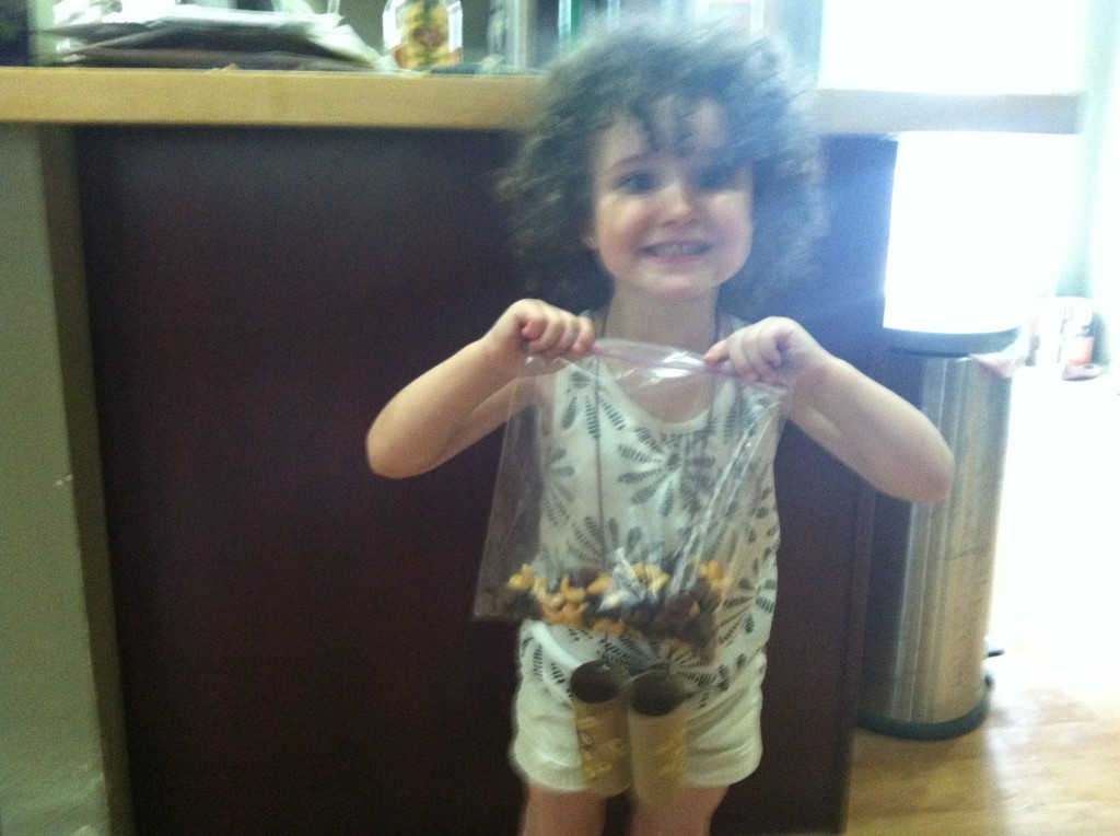 Curly is very excited about the trail mix in this picture. Her finished binoculars are around her neck.